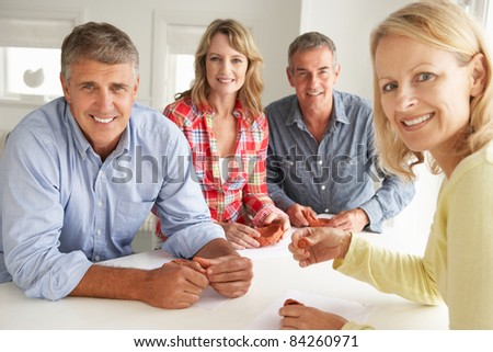 Mid age couples clay modelling - stock photo