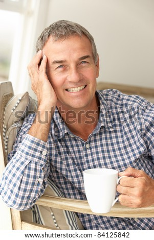 Mid age man at home - stock photo
