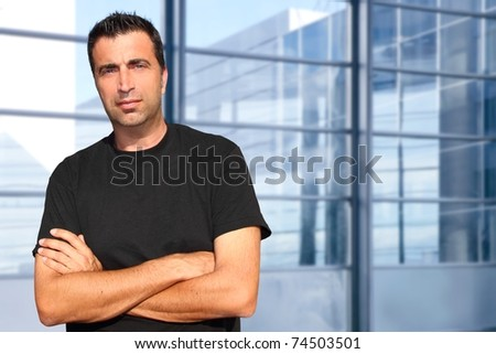Mid age man portrait in urban modern office buildings [Photo Illustration] - stock photo