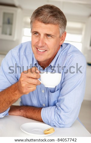 Mid age man with coffee at home - stock photo