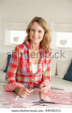 Mid age woman scrapbooking - stock photo