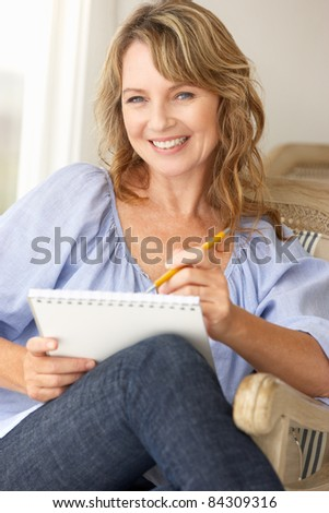 Mid age woman sketching - stock photo