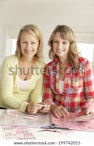 Mid age women scrapbooking - stock photo
