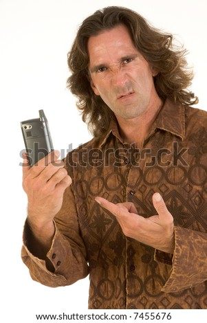 Mid-aged man with long hair apparently frustrated with his cell-phone - stock photo