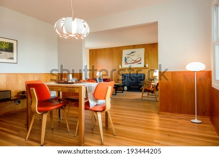 Mid Century Dining room, craftsman style with red chairs and wooden table.  - stock photo