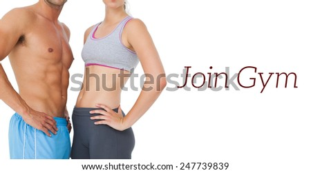 Mid section of a fit young couple standing over white background - stock photo