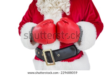 Mid section of santa with boxing gloves on white background - stock photo