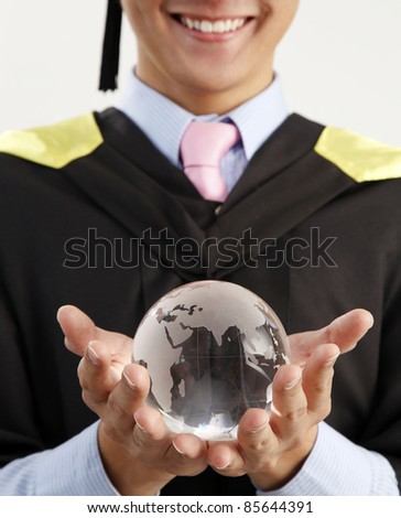 mid section of the man holding glass globe - stock photo