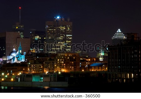 Mid-town Montreal by night - illuminated cathedral and skyscrapers - stock photo