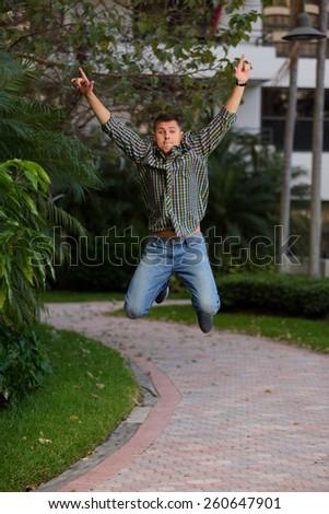 Midair shot of a man jumping - stock photo