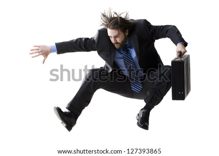 Midair shot of a young businessman jumping with briefcase