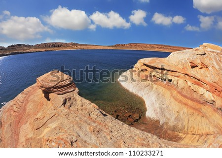 Midday heat. The artificial Lake Powell in the red desert of California.  Photo taken fisheye lens - stock photo