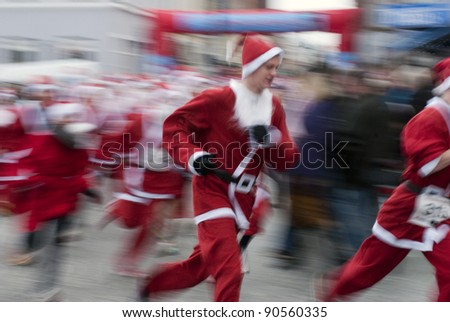 MIDDELFART - DECEMBER 11: Father Christmas Run all over in Middelfart, Denmark. Christmas run in Denmark December 11, 2011 in Middelfart, Denmark. - stock photo
