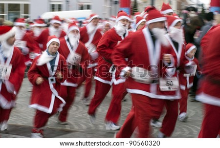 MIDDELFART - DECEMBER 11: Father Christmas Run in Middelfart, Denmark. Christmas run in Denmark December 11, 2011 in Middelfart, Denmark. - stock photo