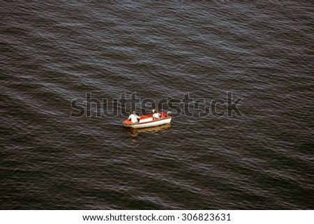 MIDDELFART, DENMARK â?? AUGUST, 13: Fishing boat with relaxed fisher men on Little Belt close to The Old Little Belt Bridge,  13th August 2015. - stock photo