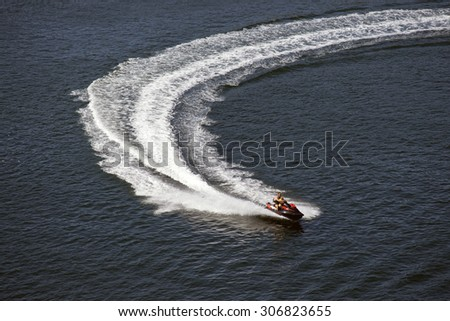 MIDDELFART, DENMARK â?? AUGUST, 13: Speedy jet-skis on Little Belt close to The Old Little Belt Bridge,  13th August 2015. - stock photo