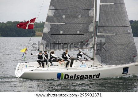 MIDDELFART, DENMARK - JULY 12,2015 : ISAF Women's Match Racing World Championship  - Semi Final - USA and Denmark. - Team Camilla Ulrikkeholm  number 2 overall. - stock photo