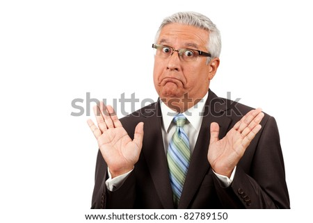 Middle age business man wearing a suit and glasses with a dumbfounded expression on a white background.