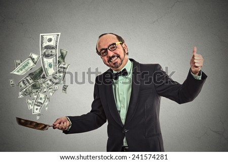 Middle age businessman juggling money dollar bills banknotes isolated on grey wall background