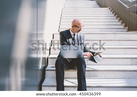 Middle-age contemporary businessman - stock photo