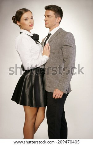 Middle Age Couple in Black and White Shade Fashion Attire Portrait. Isolated on Gray background. - stock photo