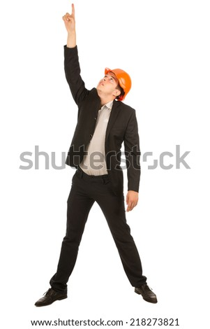 Middle Age Male Engineer in Orange Helmet Wearing Black Coat and Pants Pointing Up. Isolated on Full White Background. - stock photo