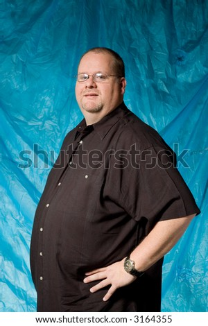 middle-age man against portrait backdrop