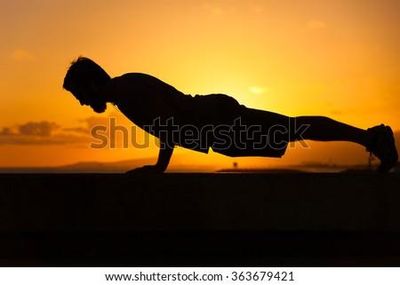 Middle age man doing push ups.  - stock photo