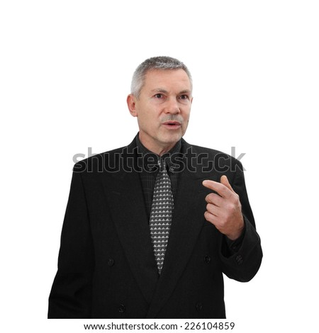 Middle age man in business classic black suit speaks gesturing isolated on white background - stock photo