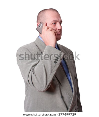 Middle age man in business suit calls by mobile phone isolated on white background . - stock photo