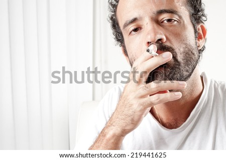 Middle Age man smoking indoor . - stock photo
