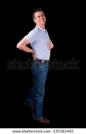 Middle Age Man Suffering Back Pain Black Background - stock photo