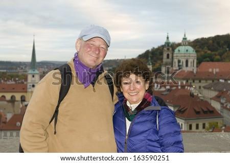 middle age senior smiling man woman tourist couple Castle District Prague Czech Republic - stock photo
