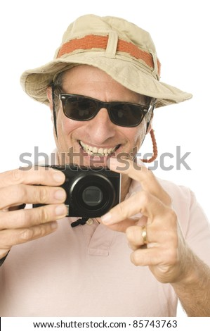 middle age senior tourist male wearing funny sun hat and taking picture with digital camera