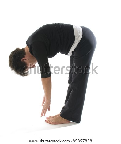 middle age senior woman yoga exercise position hamstring stretch toe touch - stock photo