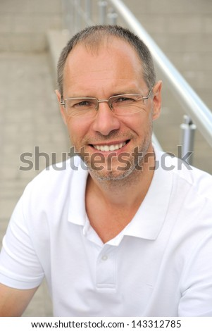 Middle age smiling man portrait - stock photo