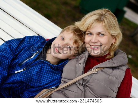 middle age woman and son outdoors