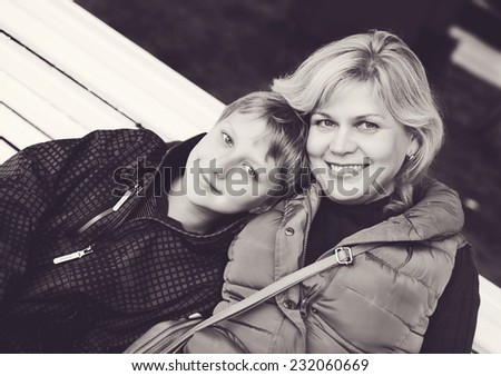 middle age woman and son outdoors - stock photo