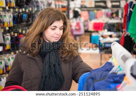 Middle age woman browsing a department store to buy presents for San Valentine Day  - stock photo