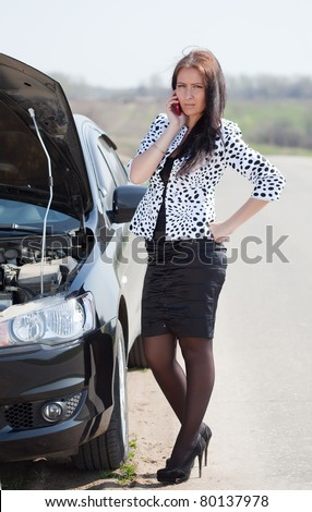 middle age  woman waiting support near  her broken car - stock photo