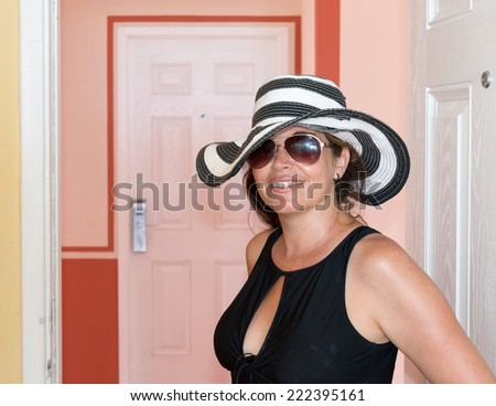 Middle age woman wearing a hat in the tropics during her summer holidays - stock photo