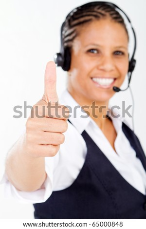 middle aged african american businesswoman giving thumb up