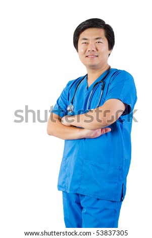 middle aged asian male doctor standing with arms crossed - stock photo