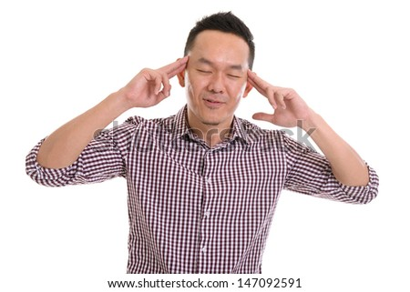 Middle aged Asian man with pensive expression , isolated on white background. Asian male model. - stock photo