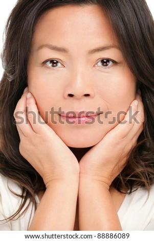 Middle aged asian woman beauty portrait. Closeup of mid age Chinese Asian female model. - stock photo