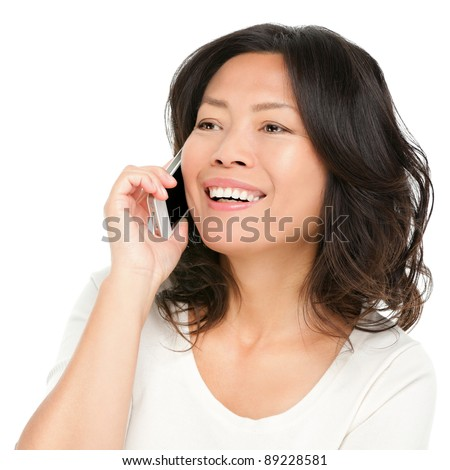 Middle aged Asian woman on smartphone. Beautiful mature Chinese Asian woman talking on mobile phone isolated on white background. - stock photo