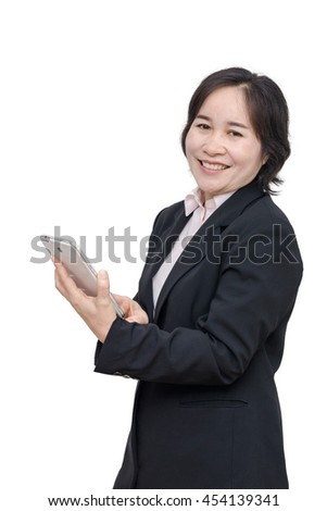 Middle aged asian woman smiles over white background