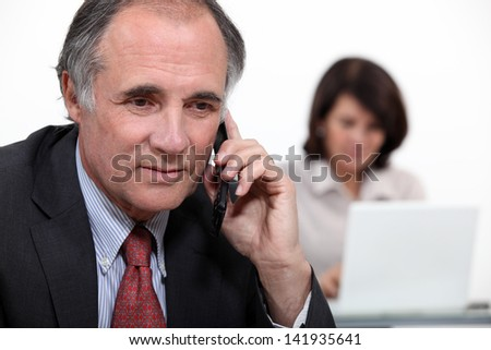 Middle-aged business couple - stock photo