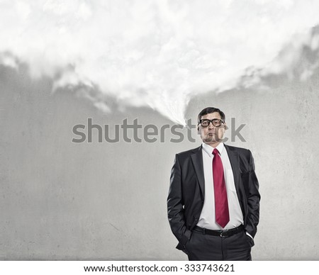 Middle aged businessman and white blank cloud above his head