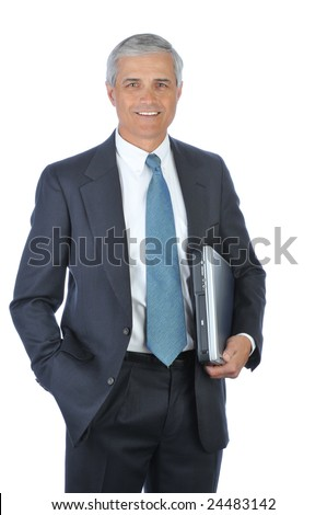 Middle Aged Businessman carrying Laptop Under His arm with hand in pocket isolated on white